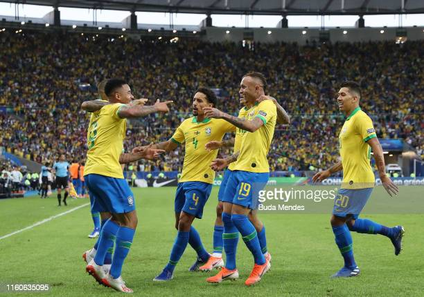 Everton of Brazil celebrates after scoring the first goal of his team with teammates during the Copa America Brazil 2019 Final match between Brazil...