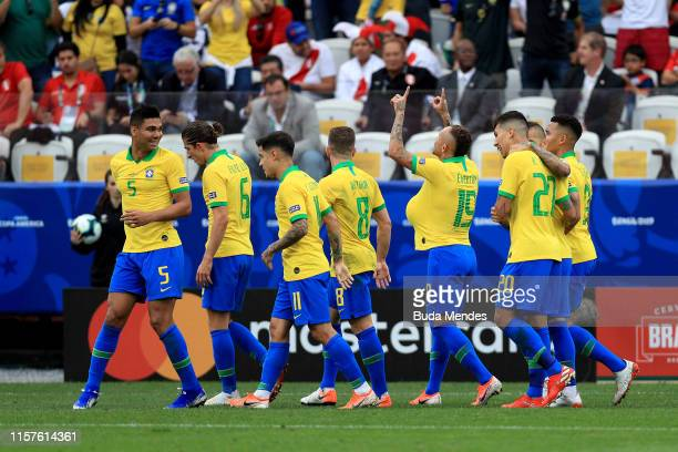 Everton of Brazil celebrates after scoring the third goal of his team with teammates during the Copa America Brazil 2019 group A match between Peru...