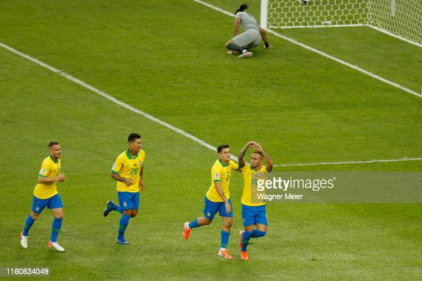 Everton of Brazil celebrates with teammates after scoring the first goal of his team during the Copa America Brazil 2019 Final match between Brazil...