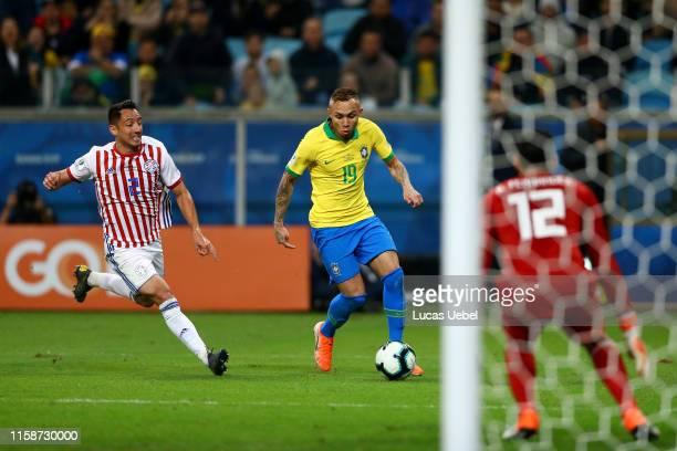 Everton of Brazil controls the ball under pressure of Ivan Piris of Paraguay during the Copa America Brazil 2019 quarterfinal match between Brazil...