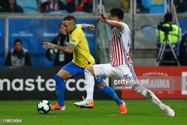 Everton of Brazil fights for the ball with Gustavo Gomez of Paraguay during the Copa America Brazil 2019 quarterfinal match between Brazil and...