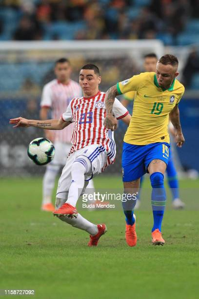 Everton of Brazil fights for the ball with Junior Alonso of Paraguay during the Copa America Brazil 2019 quarterfinal match between Brazil and...