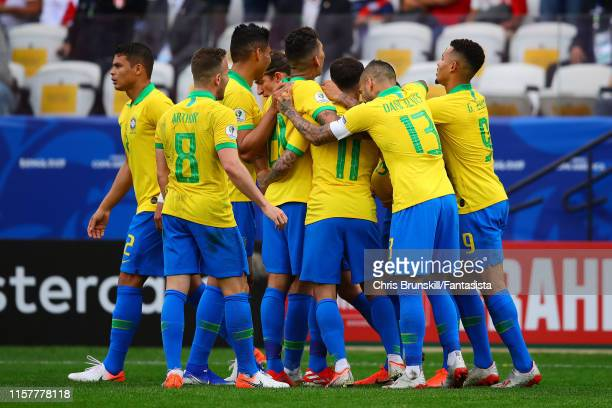 Everton of Brazil is congratulated by his team-mates after scoring his side's third goal during the Copa America Brazil 2019 group A match between...