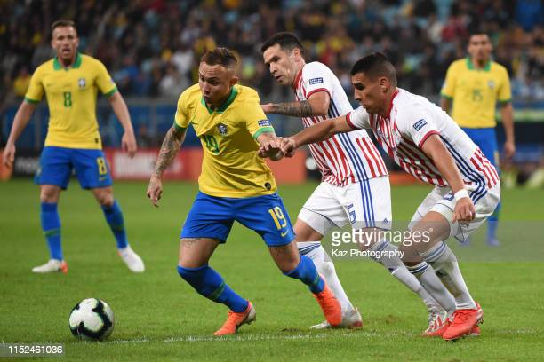 Everton of Brazil keeps the ball under the pressure from Juan Escobar and Richard Sanchez of Paraguay during the Copa America Brazil 2019...