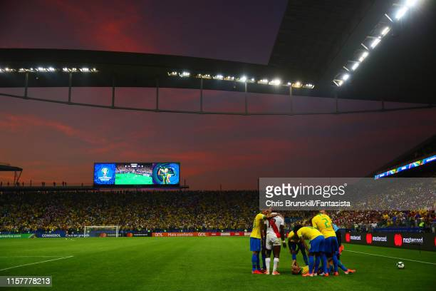 Everton of Brazil lies injured during the Copa America Brazil 2019 group A match between Peru and Brazil at Arena Corinthians on June 22, 2019 in Sao...