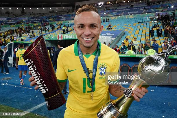 Everton of Brazil poses with the Man of the Match and top scorer trophies after winning during the Copa America Brazil 2019 Final match between...