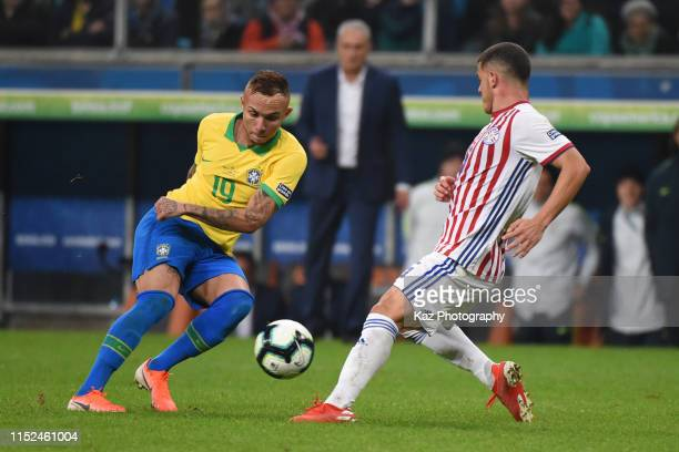 Everton of Brazil turns back the ball under the pressure from Richard Sanchez of Paraguay during the Copa America Brazil 2019 quarterfinal match...
