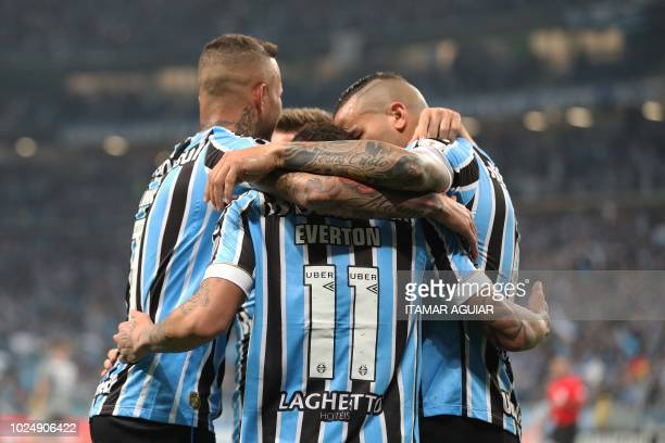 Everton of Brazil's Gremio celebrates with teammates after scoring against Argentina's Studiantes during their Copa Libertadores 2018 football match...