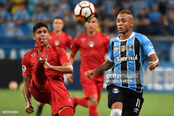 Everton of Brazils Gremio vies for the ball with Alan Franco of Argentina's Independiente during their Recopa Sudamericana 2018 second leg final...