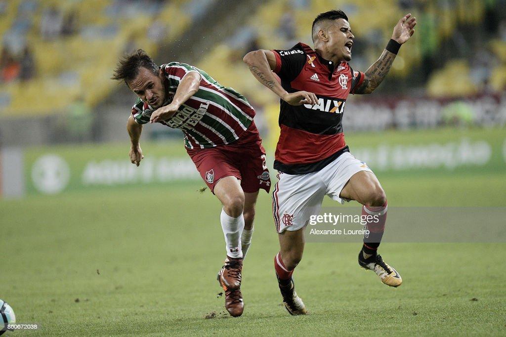 Everton (R) of Flamengo battles for the ball with Lucas of Fluminense during the match between Flamengo and Fluminense as part of Brasileirao Series A 2017 at Maracana Stadium on October 12, 2017 in Rio de Janeiro, Brazil.