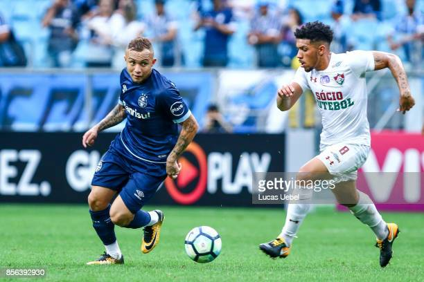 Everton of Gremio battles for the ball against Wendel of Fluminense during the match Gremio v Fluminense as part of Brasileirao Series A 2017 at...