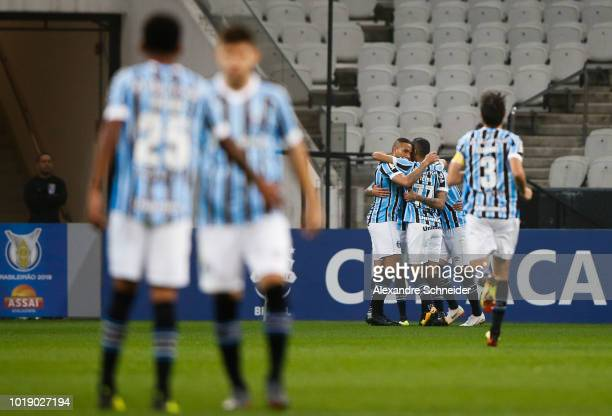 Everton of Gremio celebrates after scoring their first goal during the match against Gremio for the Brasileirao Series A 2018 at Arena Corinthians...