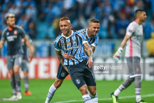 Everton of Gremio celebrates with teammate after scoring the first goal of his team during the match between Gremio and Estudiantes as part of Copa...