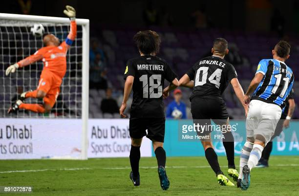 Everton of Gremio scores the opening goal during the FIFA Club World Cup UAE 2017 semifinal match between Gremio FBPA and CF Pachuca on December 12...