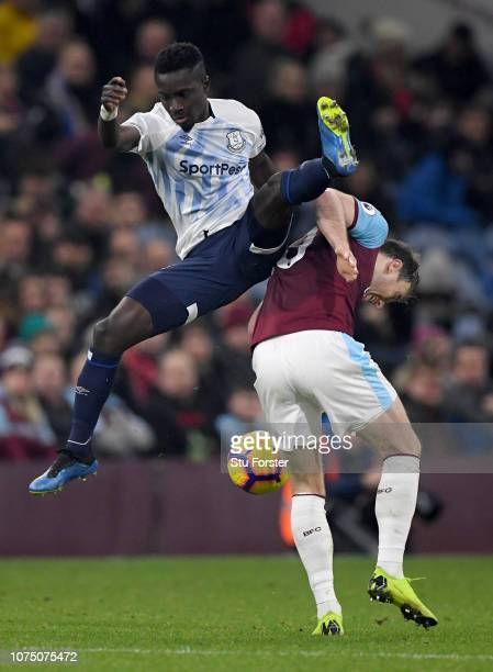 Everton player Idrissa Gueye is challenged by Ashley Barnes of Burnley during the Premier League match between Burnley FC and Everton FC at Turf Moor...