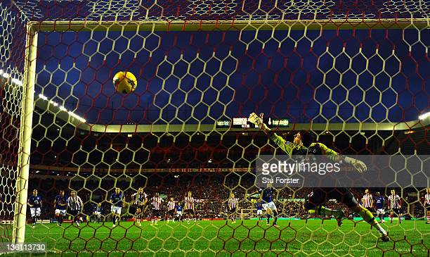 Everton player Leighton Baines scores from the penalty spot past Sunderland keeper Kieran Westwood during the Barclays Premier League match between...