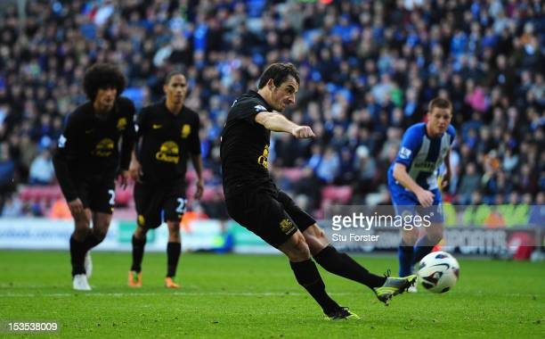 Everton player Leighton Baines scores the second Everton goal from the penalty spot during the Barclays Premier League game between Wigan Athletic...