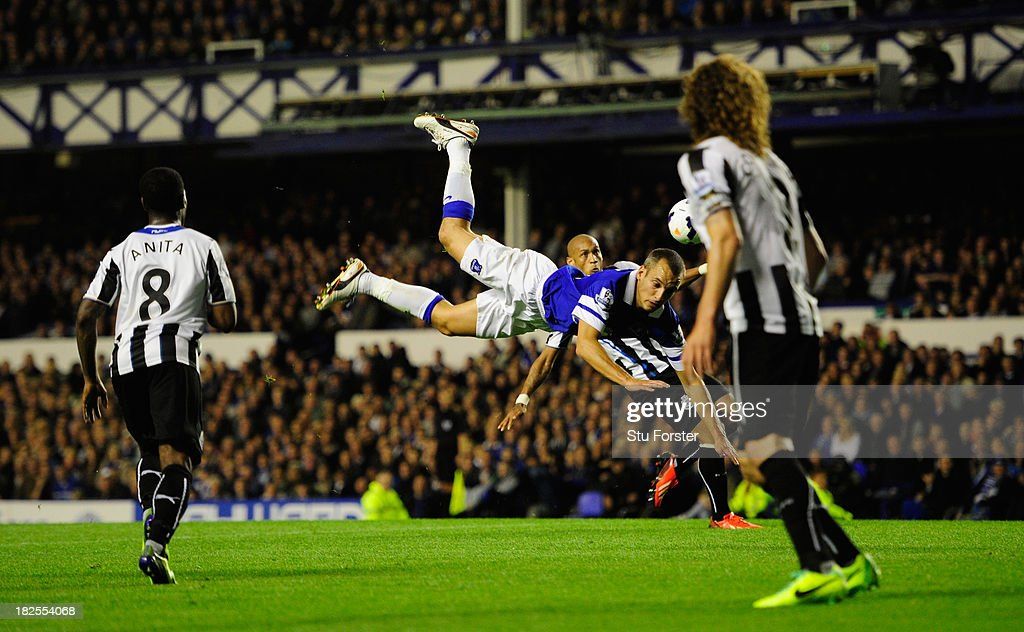 Everton player Leon Osman goes airbourne during the Barclays Premier League match between Everton and Newcastle United at Goodison Park on September 30, 2013 in Liverpool, England.