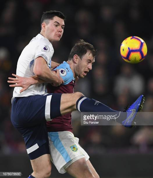 Everton player Michael Keane challenges Ashley Barnes of Burnley during the Premier League match between Burnley FC and Everton FC at Turf Moor on...