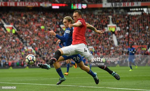 Everton player Tom Davies challenges Phil Jones during the Premier League match between Manchester United and Everton at Old Trafford on September 17...