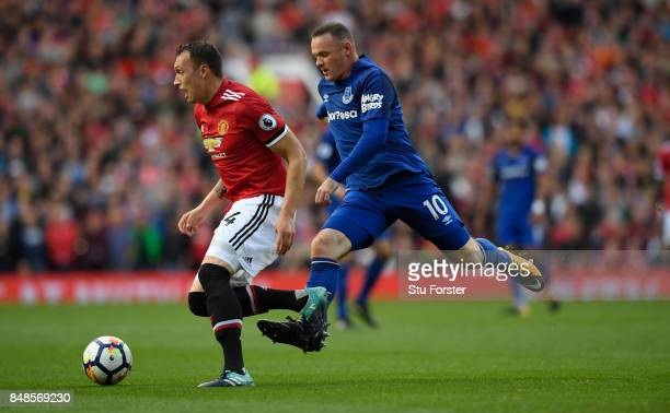 Everton player Wayne Rooney challenges Phil Jones during the Premier League match between Manchester United and Everton at Old Trafford on September...
