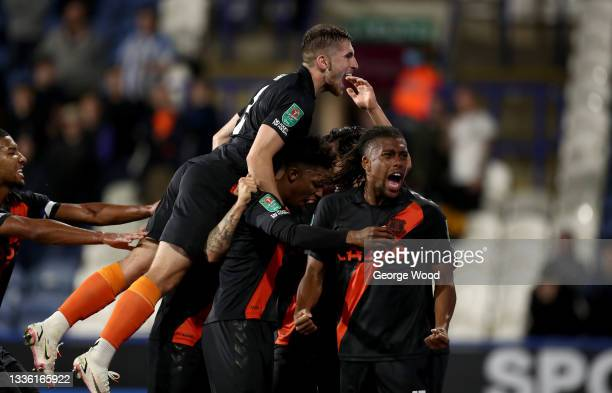 Everton players celebrate after the second goal scored by Andros Townsend of Everton during the Carabao Cup second round match between Huddersfield...