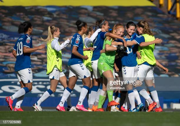 Everton players celebrate at the final whistle after the Womens FA Cup Quarter Final match between Everton FC and Chelsea FC at Goodison Park on...