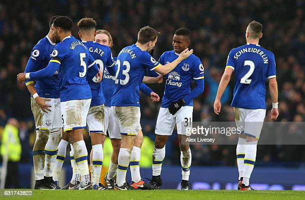 Everton players celebrate following their team's 40 victory during the Premier League match between Everton and Manchester City at Goodison Park on...
