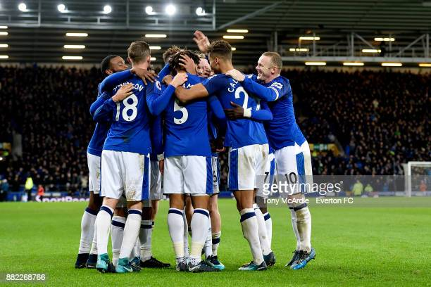 Everton players celebrate the goal of Ashley Williams during the Premier League match between Everton and West Ham United at Goodison Park on...