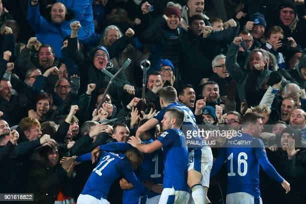 Everton players celebrate with the crowd after Everton's Icelandic midfielder Gylfi Sigurdsson scored their first goal to equalise 11 during the...