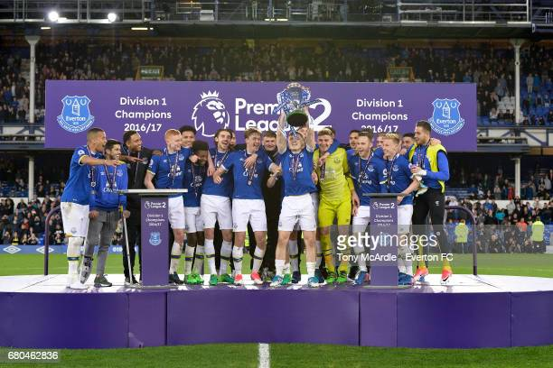 Everton players celebrate with the trophy after the Premier League 2 match between Everton U23 and Liverpool U23 at Goodison Park on May 8 2017 in...