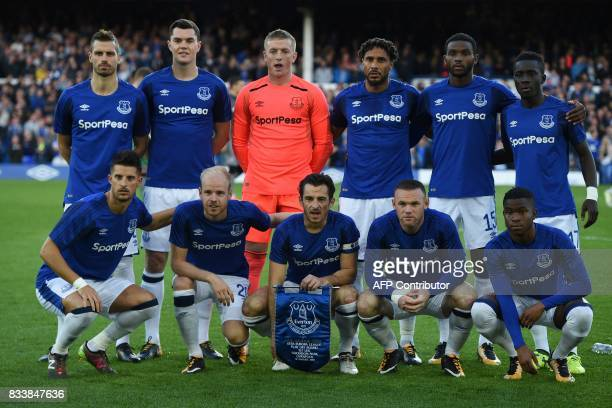 Everton players Everton's French midfielder Morgan Schneiderlin Everton's English defender Michael Keane Everton's English goalkeeper Jordan Pickford...