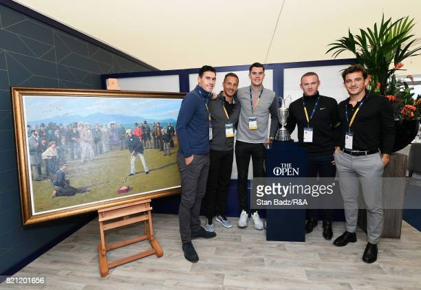 Everton players Gareth Barry Phil Jagielka Michael Keane Wayne Rooney and Leighton Baines pose with the Claret Jug during the final round of the...
