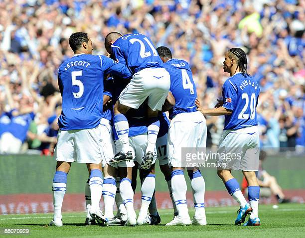 Everton players mob Louis Saha after he scored the opening goal against Chelsea in the FA Cup final at Wembley in north Londonon May 30 2009 AFP...