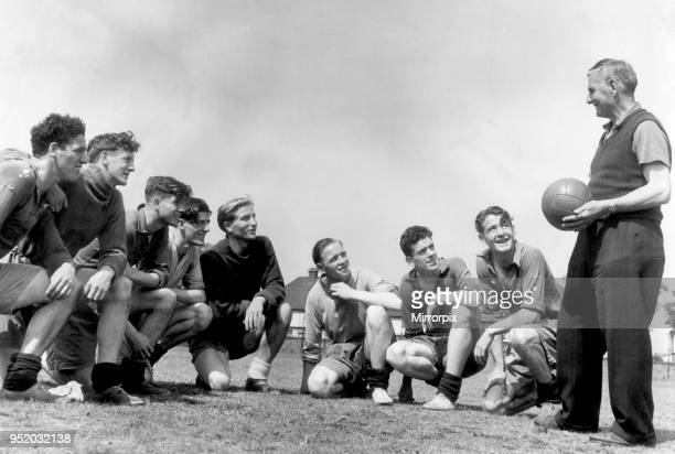Everton players pictured with coach Harry Cooke during a training session Everton players left to right Harry Leyland Jimmy O'Neill Joe Easthope John...