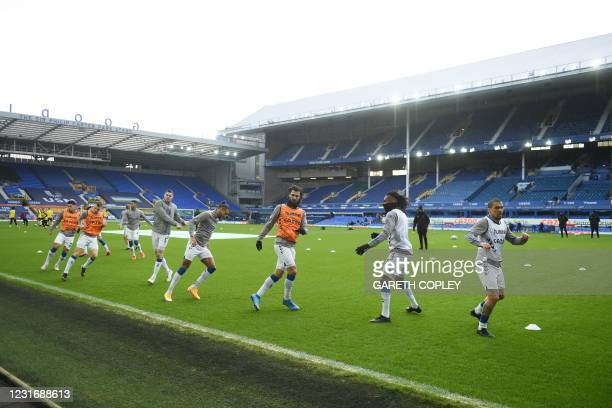 Everton players warm up for the English Premier League football match between Everton and Burnley at Goodison Park in Liverpool, north west England...