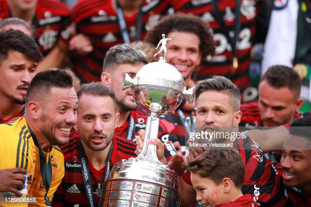 Everton Ribeiro and Diego of Flamengo celebrate with the trophy after winning the final match of Copa CONMEBOL Libertadores 2019 between Flamengo and...