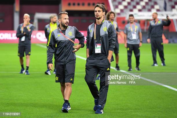 Everton Ribeiro and Rodrigo Caio of CR Flamengo walk onto the pitch as they inspect the pitch ahead of their FIFA World Cup Qatar 2019 semifinal...