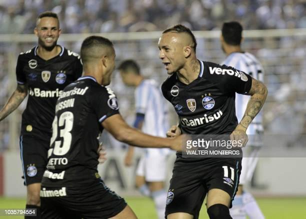 Everton Ribeiro de Freitas Castro of Brazilian Gremio celebrates with teammate Alisson Euler de Freitas Castro after scoring a goal against...