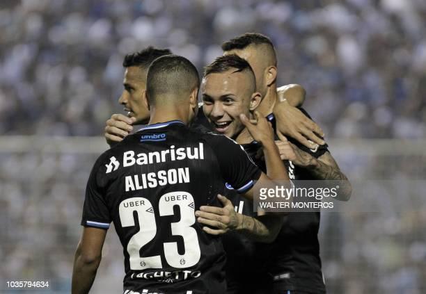 Everton Ribeiro de Freitas Castro of Brazilian Gremio celebrates with teammates after scoring a goal against Argentinian Atletico Tucuman during...