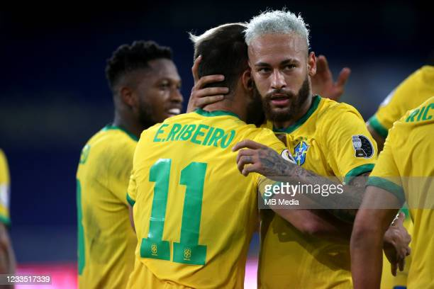 Everton Ribeiro of Brazil celebrates after scores his goal with his team mate Neymar during the match between Brazil and Peru as part of Conmebol...