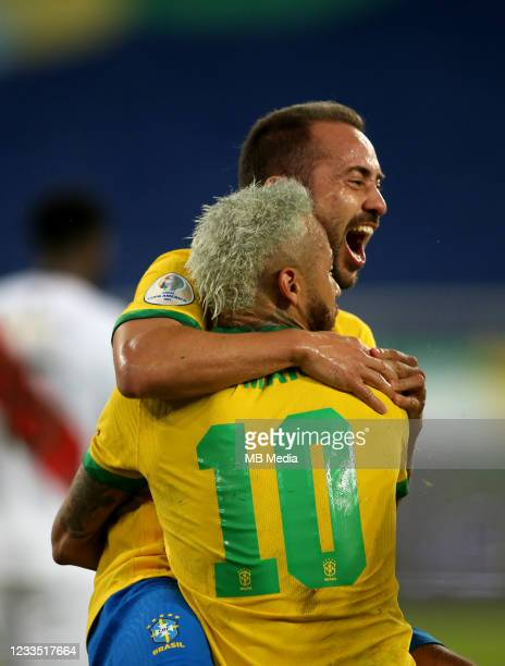 Everton Ribeiro of Brazil celebrates after scoring a goal with his team mate Neymar during the match between Brazil and Peru as part of the Conmebol...