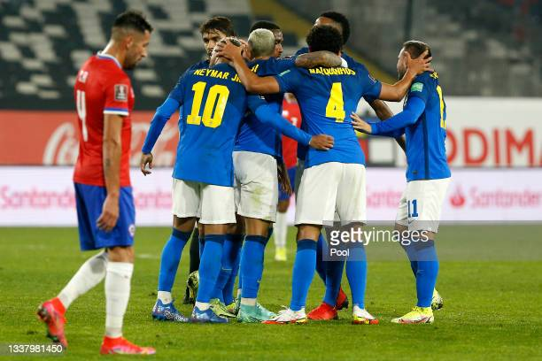 Everton Ribeiro of Brazil celebrates with teammates after scoring the first goal of his team during a match between Chile and Brazil as part of South...