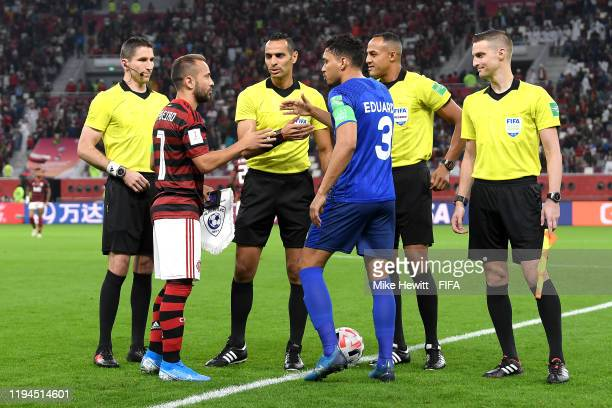 Everton Ribeiro of CR Flamengo shakes hands with Carlos Eduardo of Al Hilal SFC prior to the FIFA Club World Cup semifinal match between CR Flamengo...