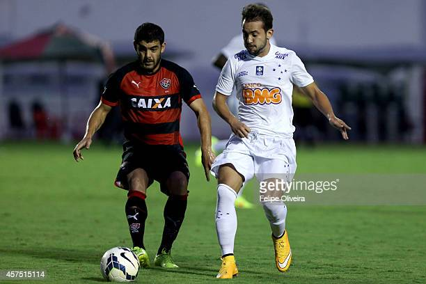 Everton Ribeiro of Cruzeiro battles for the ball with Luis Aguiar of Vitoria during the match between Vitoria and Cruzeiro as part of Brasileirao...