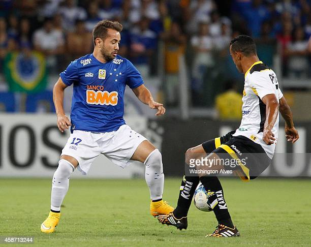 Everton Ribeiro of Cruzeiro struggles for the ball with Cleber Serginho of Criciuma during a match between Cruzeiro and Criciuma as part of...
