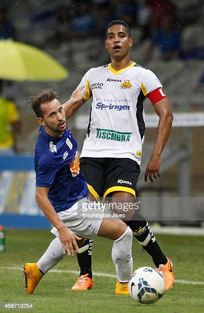 Everton Ribeiro of Cruzeiro struggles for the ball with Cleber Santana of Criciuma during a match between Cruzeiro and Criciuma as part of...