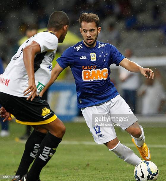 Everton Ribeiro of Cruzeiro struggles for the ball with Joilson of Criciuma during a match between Cruzeiro and Criciuma as part of Brasileirao...
