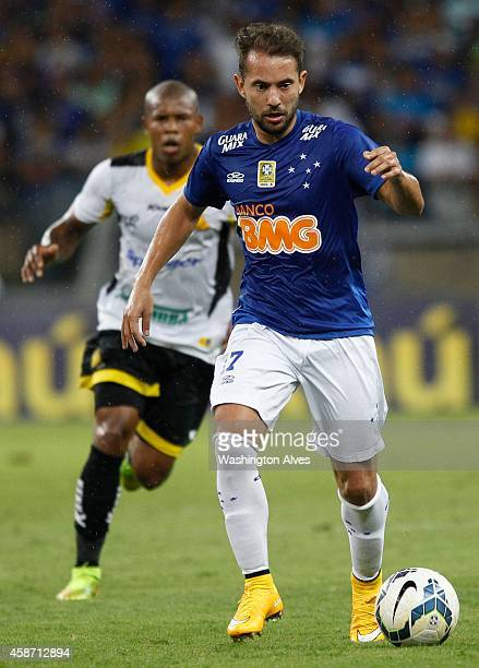 Everton Ribeiro of Cruzeiro struggles for the ball with Luis Felipe of Criciuma during a match between Cruzeiro and Criciuma as part of Brasileirao...