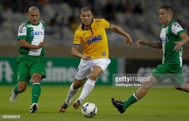 Everton Ribeiro of Cruzeiro struggles for the ball with Souza of Coritiba during a match between Cruzeiro and Coritiba as part of Brasileirao Series...